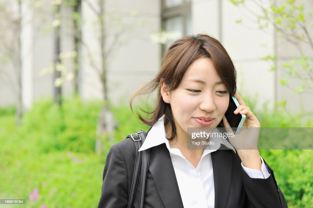 Business woman is using a smartphone : Stock Photo