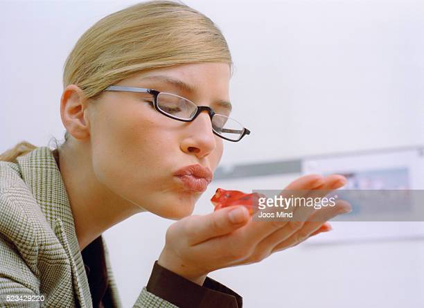 Business Woman Kissing Frog