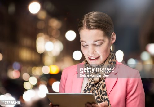 Business woman looking at handheld computer : Stock Photo