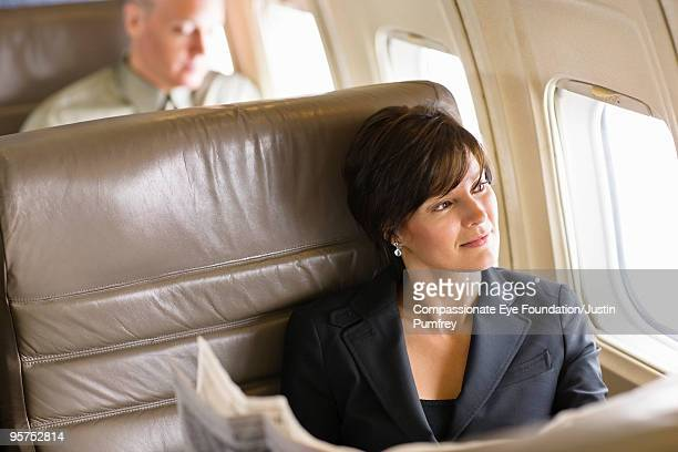 business woman looking out airplane window