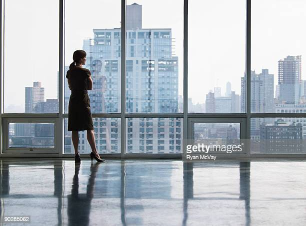 Business woman looking out window