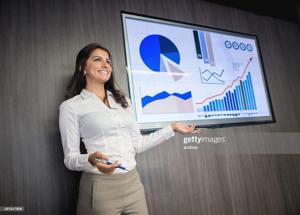 Business woman making a presentation : Stock Photo