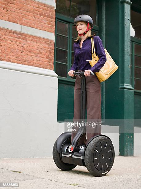 Business woman on personal transport vehicle