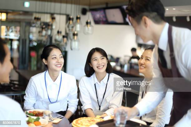 Business woman ordering food at restaurant