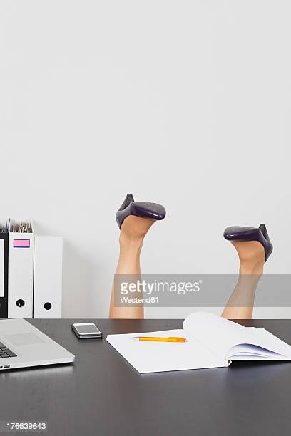 Business woman overturning behind office desk