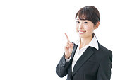 business woman pointing to something