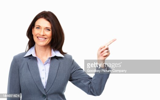 Business woman pointing up at copy space