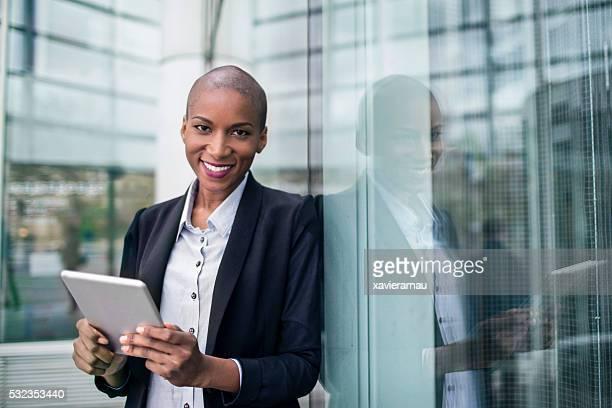 Business woman portrait using a digital tablet