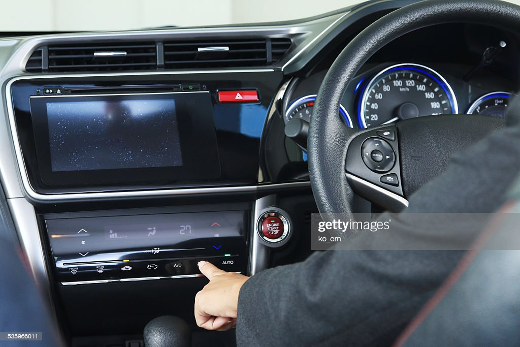 Business woman press a digital botton in mordern vehicle car : Stock Photo