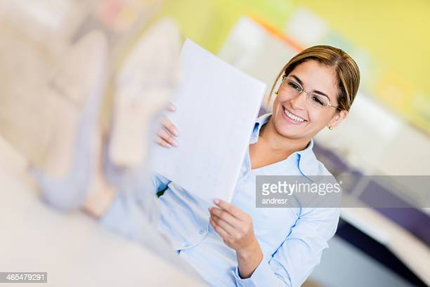 Business woman reading a contract