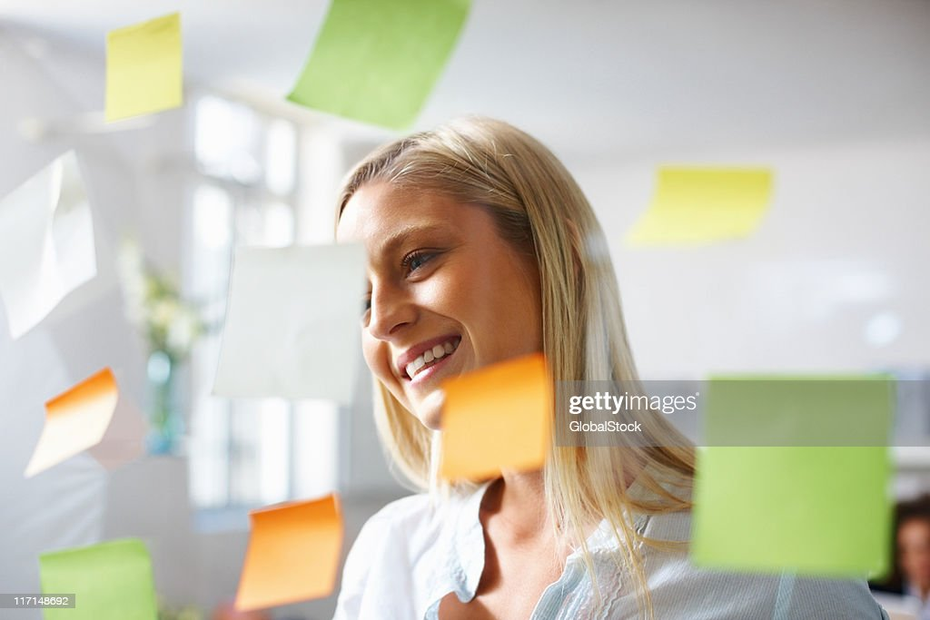 Business woman reading her schedule : Stock Photo