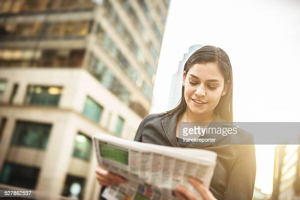 business woman reading the newspaper