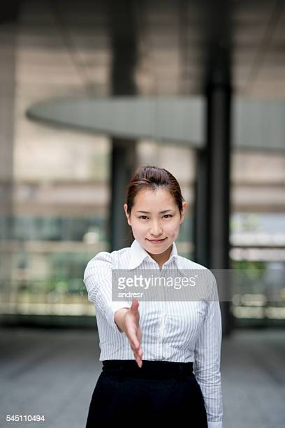 Business woman ready for a handshake