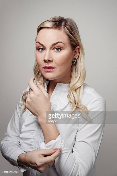 Business woman rolling up her sleeves