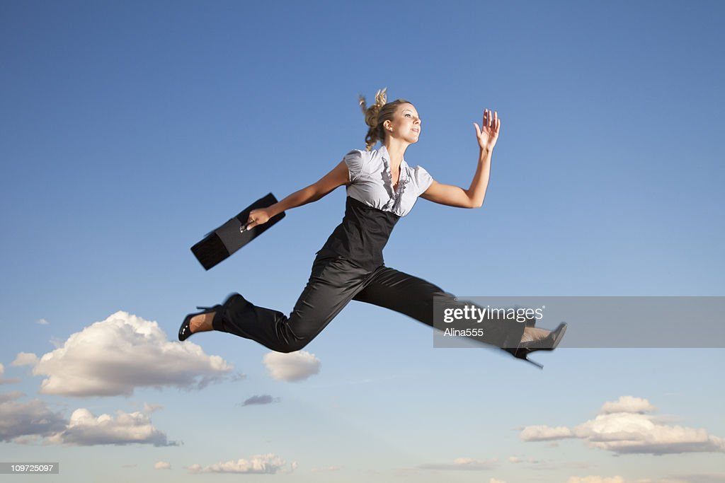 Business woman running through the air : Stock Photo