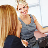 Business woman shaking hands in meeting