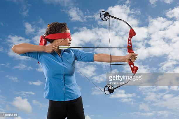 Business Woman Shooting Arrow
