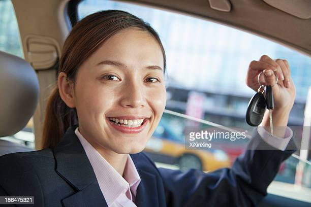 Business Woman Sitting In Car, Showing Keys, Vehicle Interior