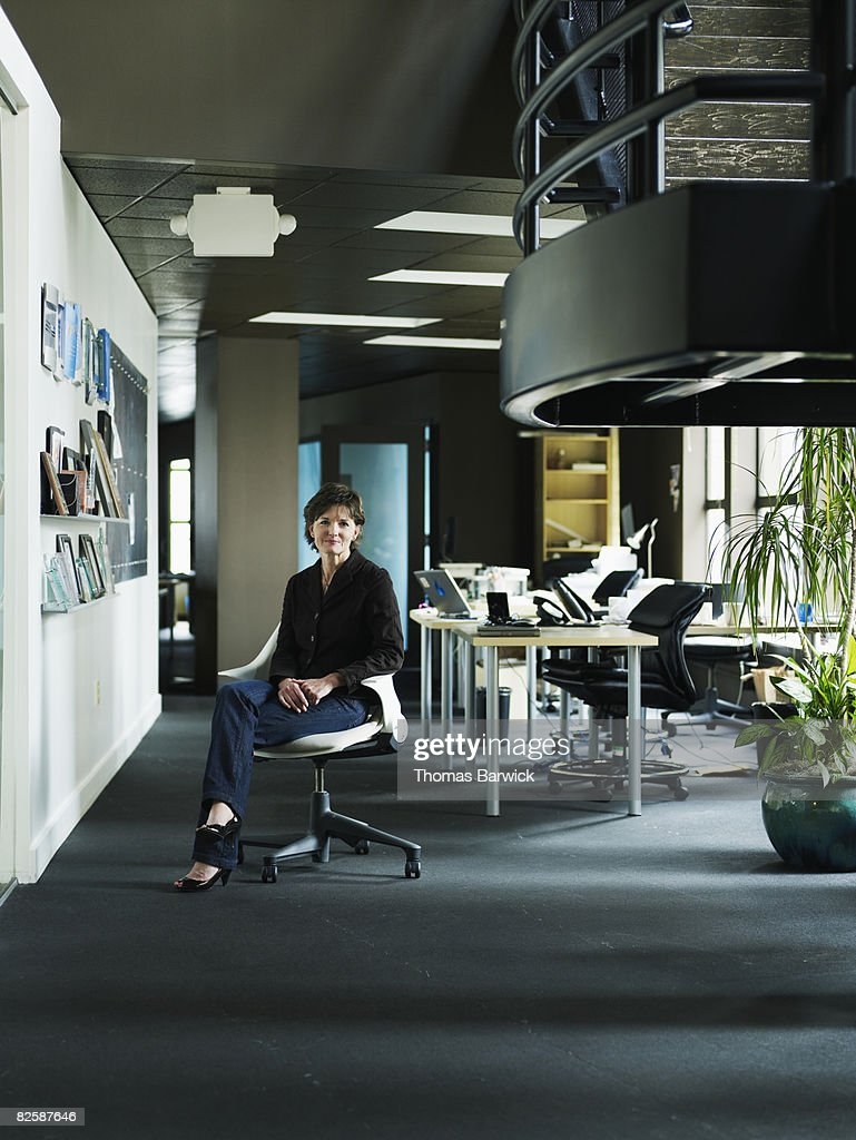 Business woman sitting in office : Stock Photo