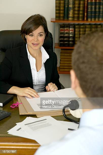 Business Woman smiling with a client