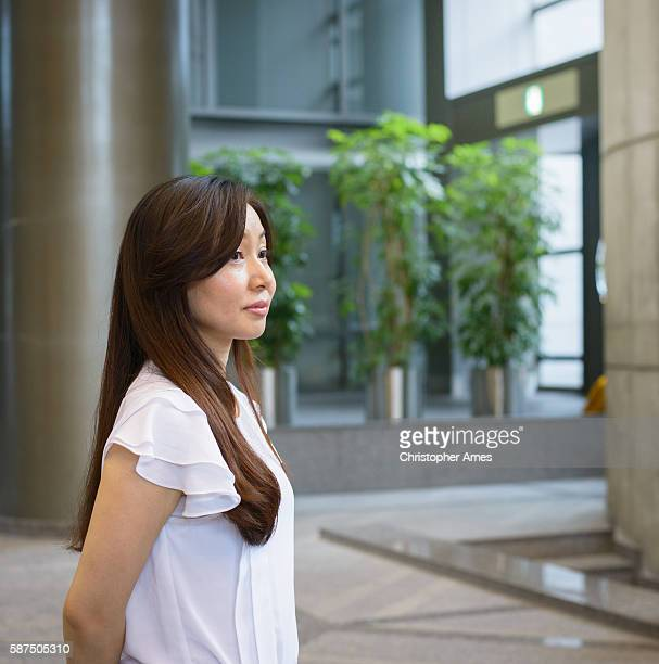 Business Woman Standing in Modern Office Building