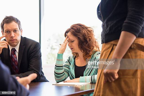 Business Woman Stressed During Team Meeting