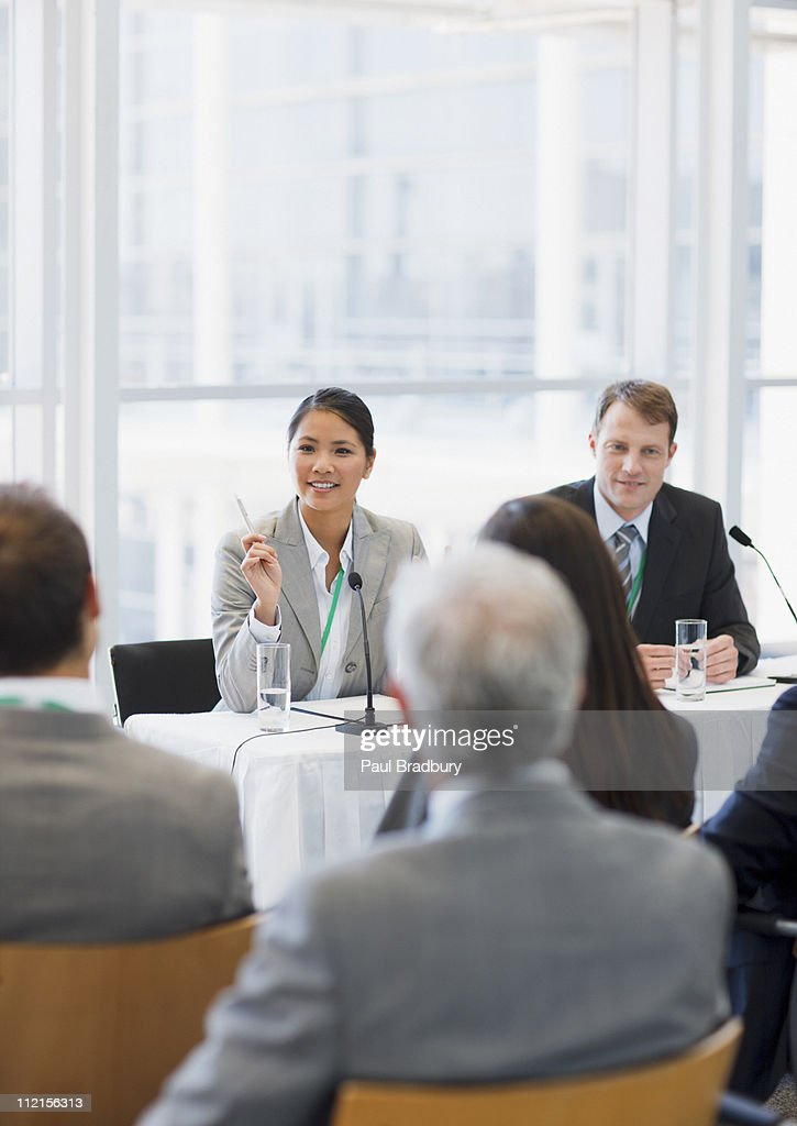 Business woman talking on panel at seminar : Stock Photo