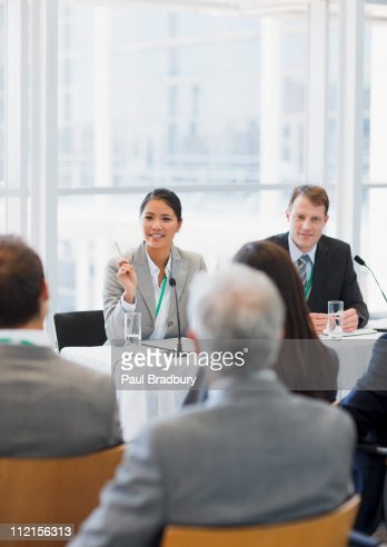 Business woman talking on panel at seminar : Stockfoto