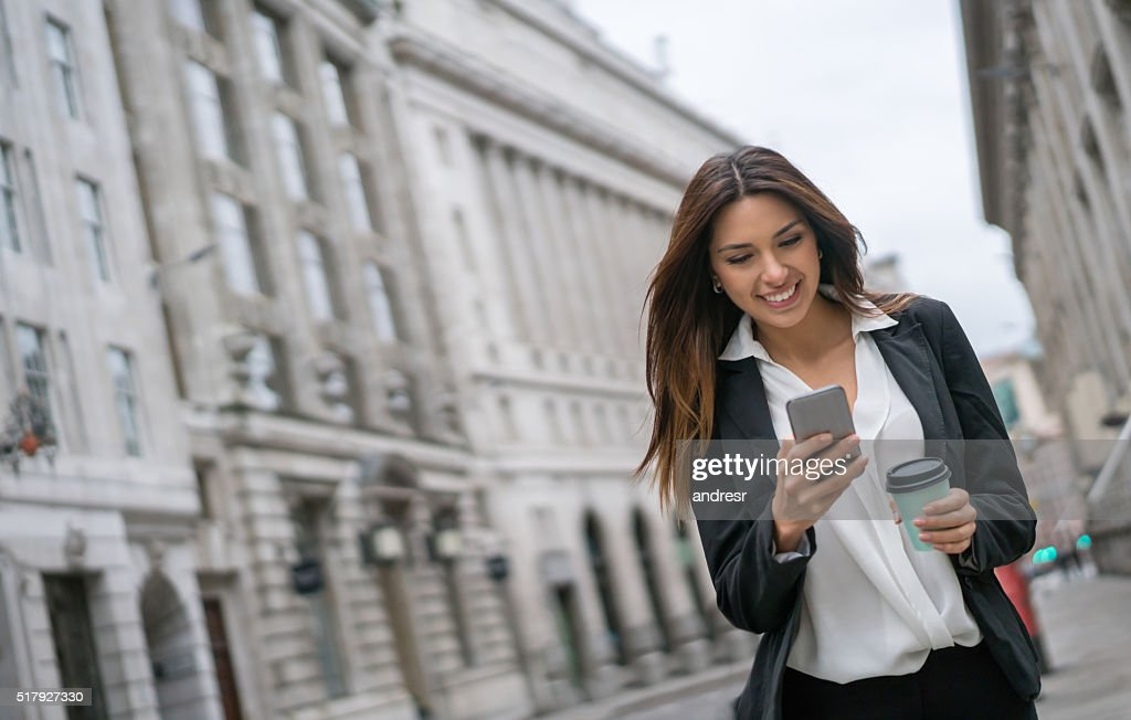 Business woman texting on her phone : Stock Photo