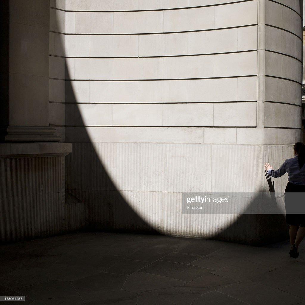Business woman touching wall : Stock Photo