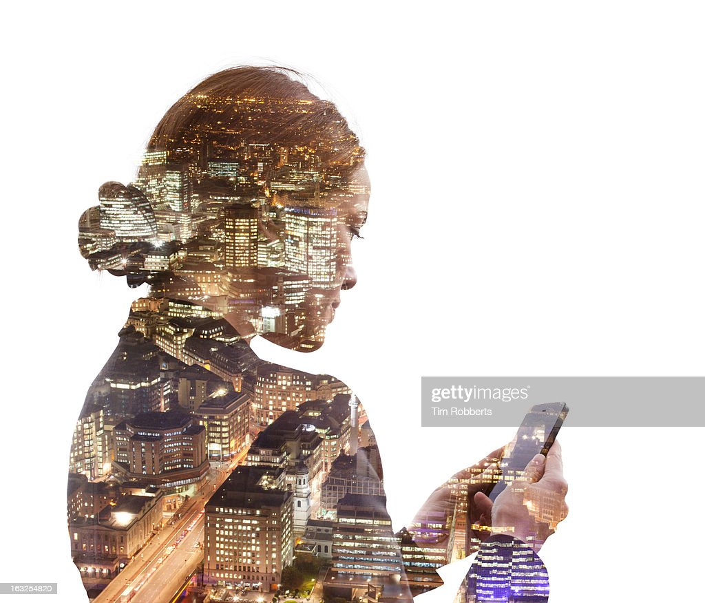 Business woman using a phone, and night city view