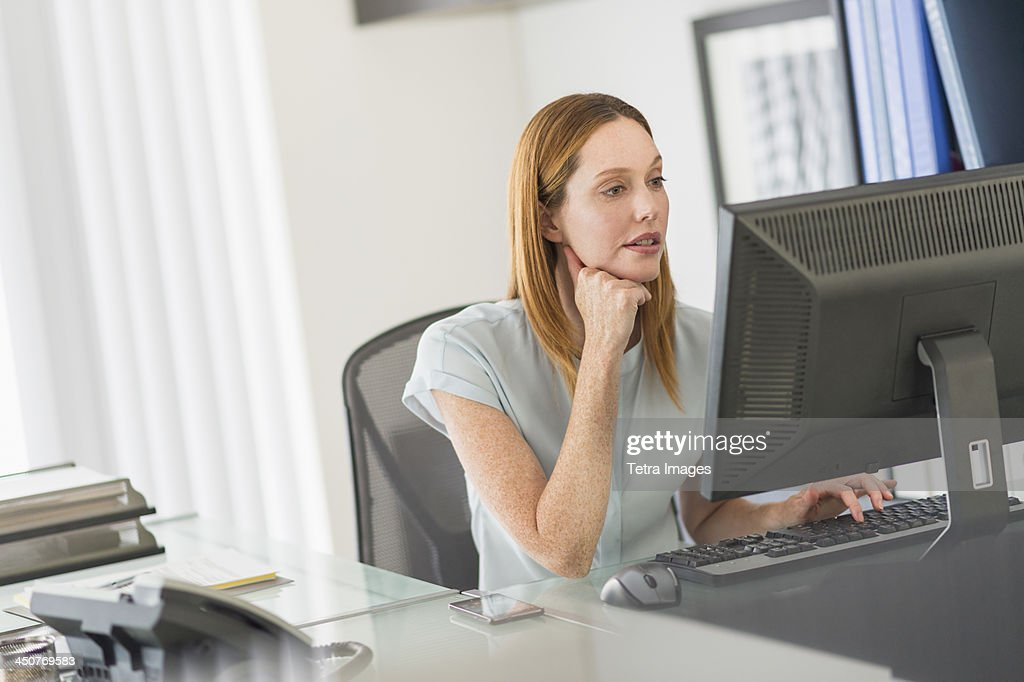 Business woman using computer in office : Stock Photo
