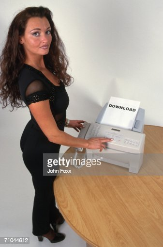 Business woman using fax machine (Digital Composite) : Stock Photo