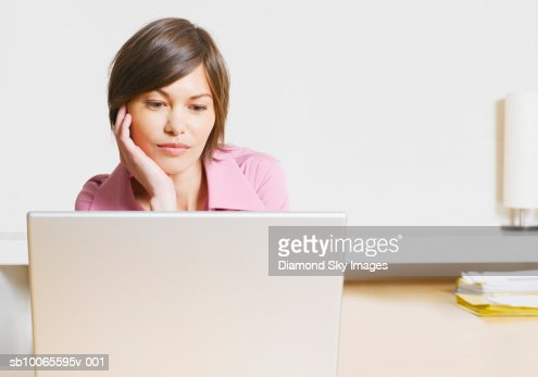 Business woman using laptop in office : Stock Photo