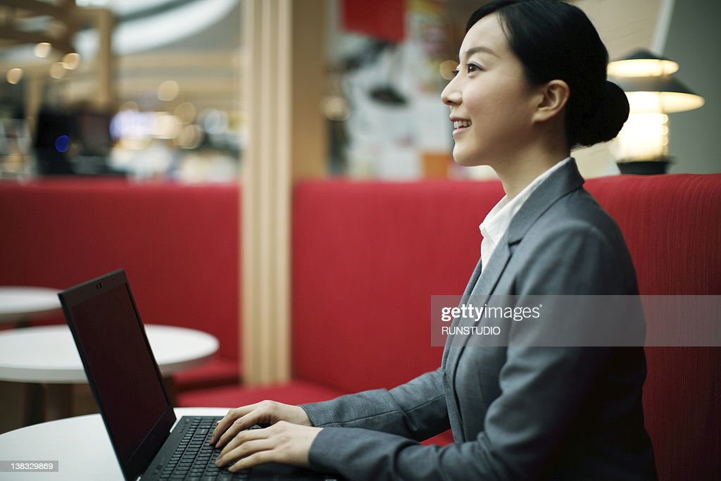 business woman using notebook PC : Stock Photo