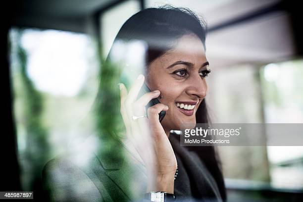 business woman using smartphone in office
