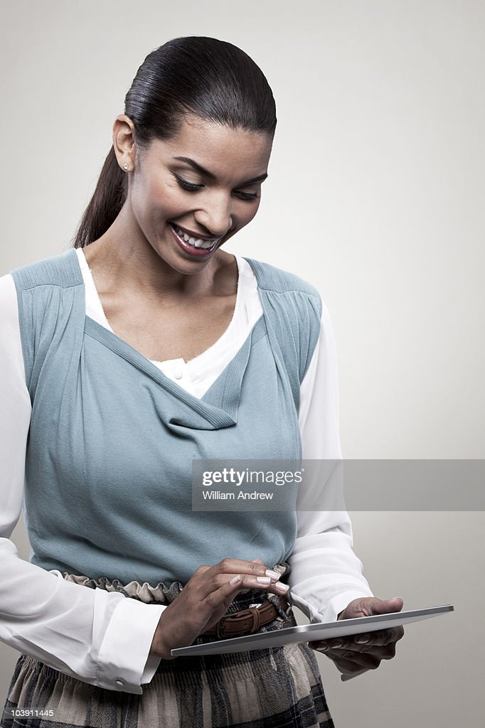 Business woman using tablet computer : Stock Photo
