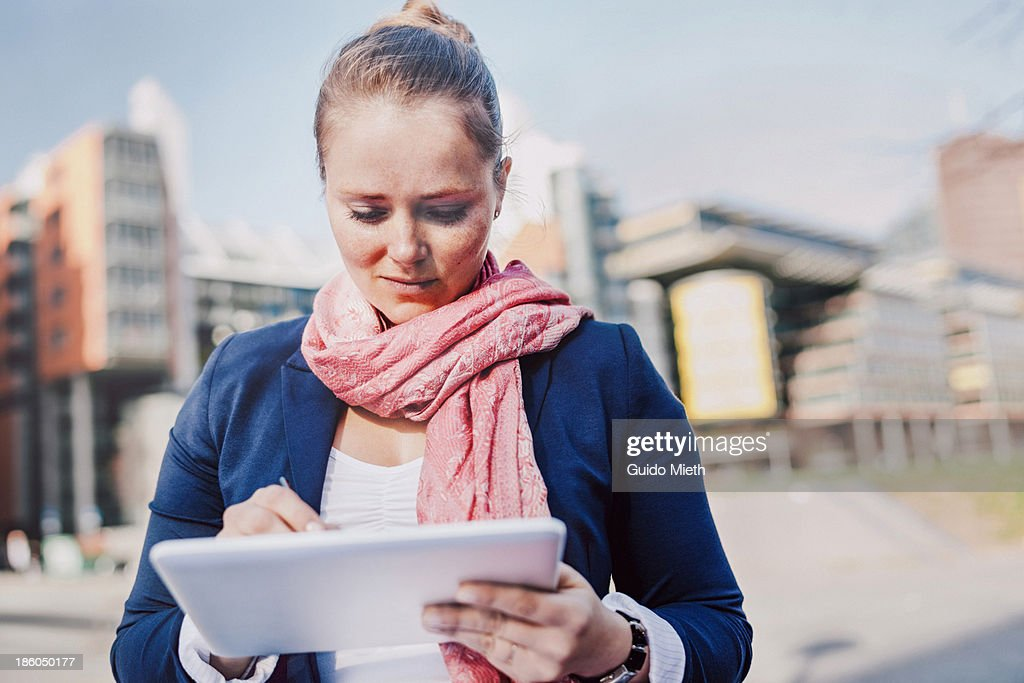 Business woman using tablet pc outdoor : Stock Photo