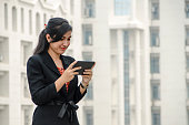 Business Woman using Tablet Phone