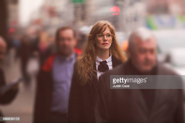 business woman walking in a crowded street