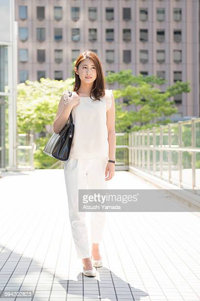 Business woman walking in city location