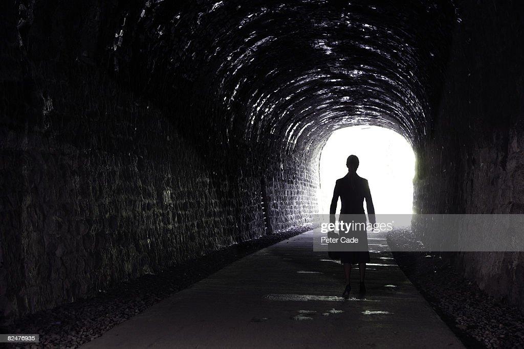 business woman walking min dark tunnel : Stock Photo