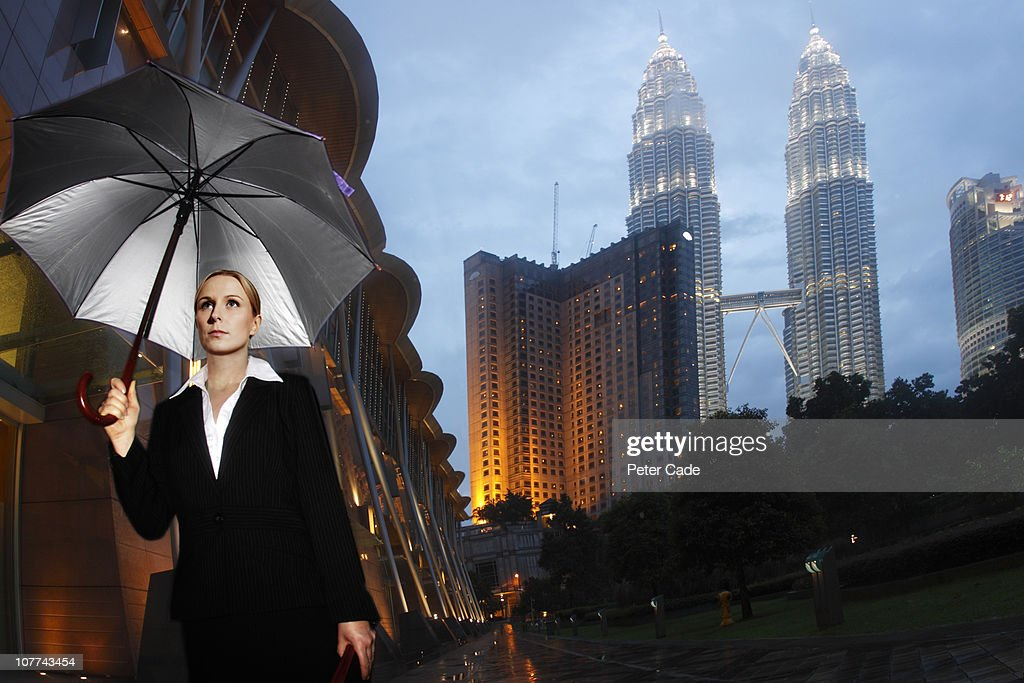 business woman walking, the Petronas Towers behind : Stock Photo