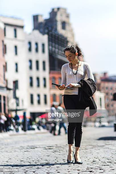 Business woman walking the streets of New York City