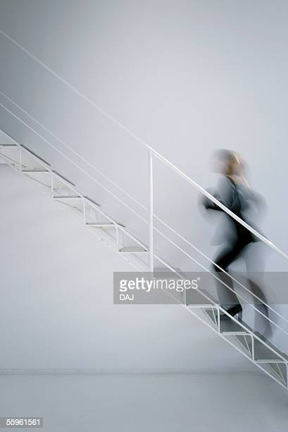 Business Woman Walking Up Stair