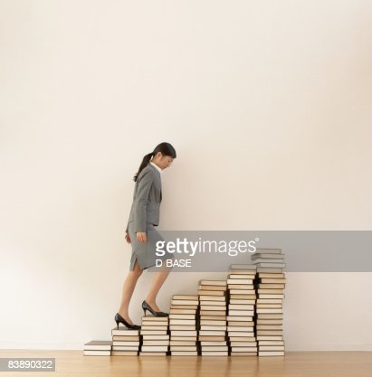 business woman  walking up steps : Stock Photo