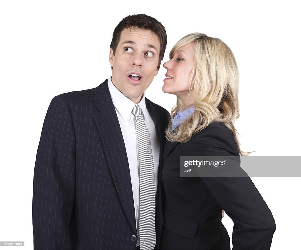 business woman whispering in mans ear stock photo getty