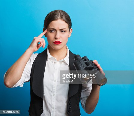 Business woman with a binoculars : Stockfoto