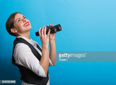 Business woman with a binoculars : Stockfoto