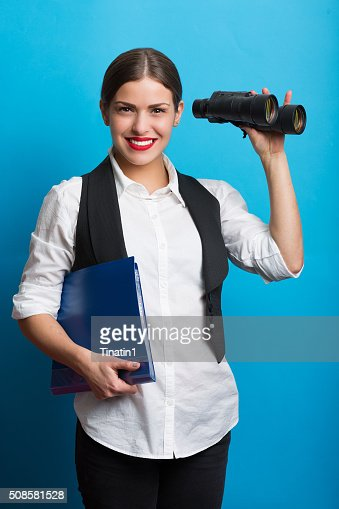 Business woman with a binoculars : Bildbanksbilder